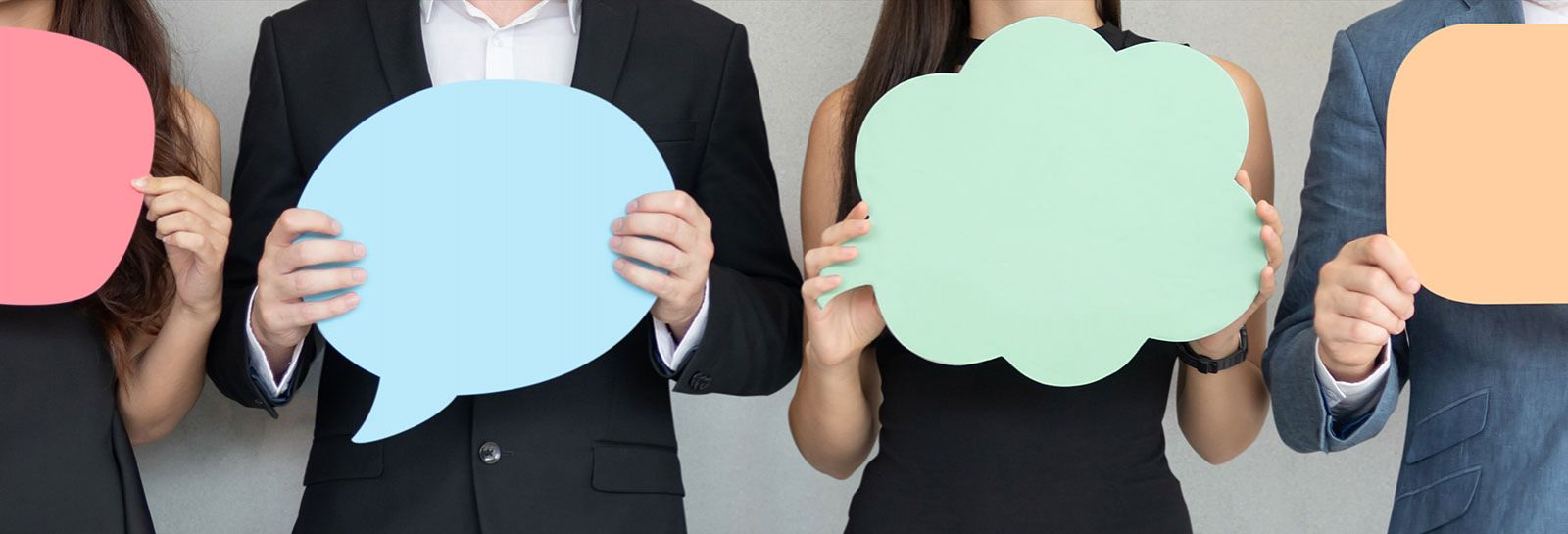 People holding cardboard speech bubbles banner image