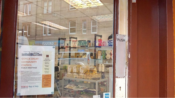 A GDCC poster in a shop window. Credit: GDCC
