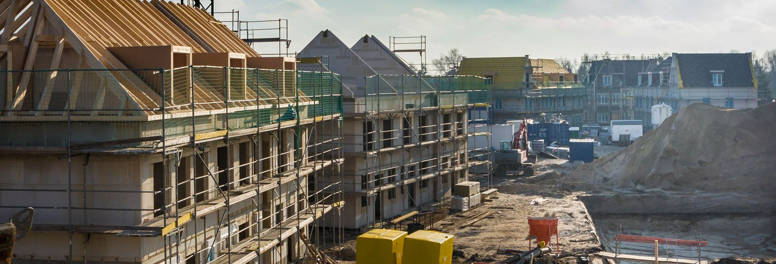 Houses under construction on building site banner image